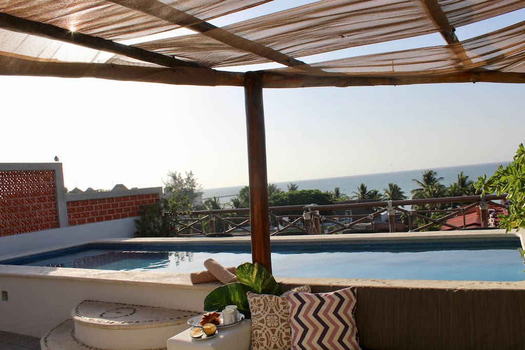 Shared solarium with expansive ocean view and lounge pool