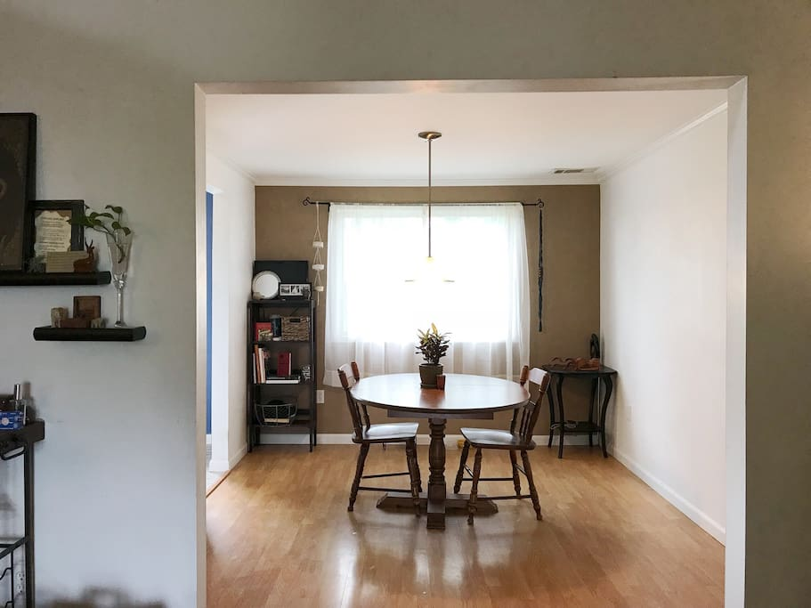 Open-concept dining room flows into the living room
