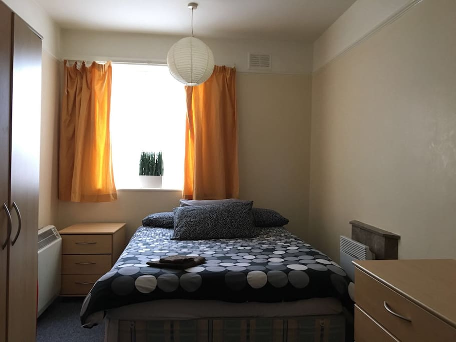 The room with a double bed and a sofa