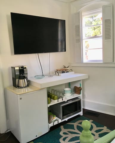 """Your """"smart"""" television. Log into your own Netflix or other account, while you relax in bed. Free WiFi. Coffee, decaf, tea, sugar and purified water provided. Mini refrigerator, microwave, coffee pot and dish ware included for use."""