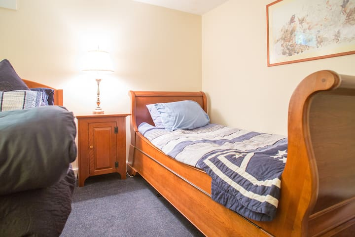 Twin bed next to the two full beds in your cozy room.