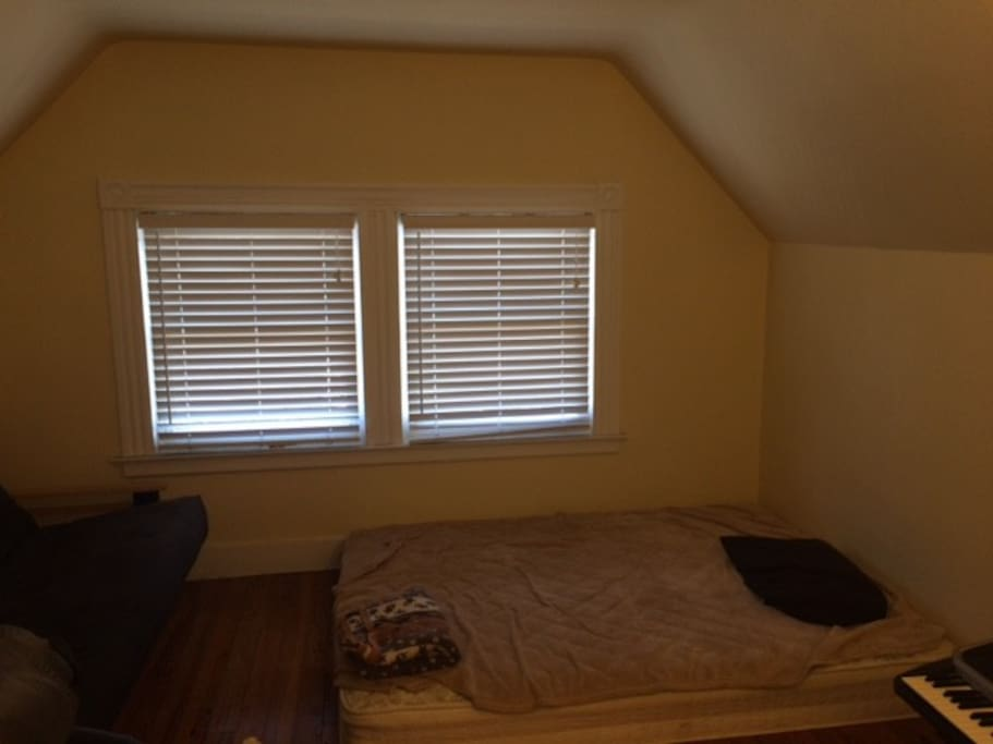 This is the other room with a bed and a futon.