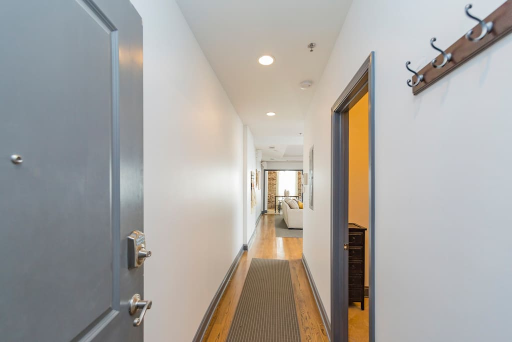 Upon entrance, there's a half bathroom to your right, and the hallway leads you to the HUGE open living area.