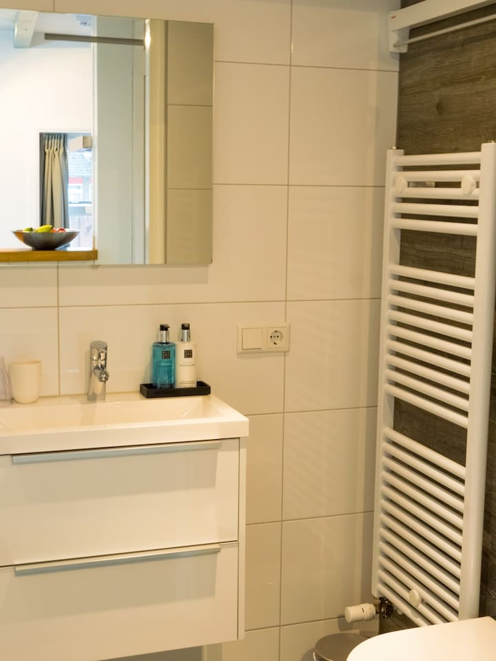 Bathroom with shower and rituals products