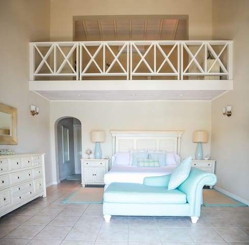 Master bedroom, showing the mezzanine above.