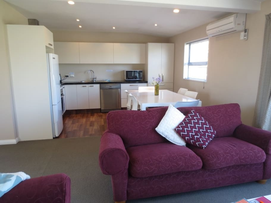 Fully equipped kitchen with modern appliances including dishwasher.