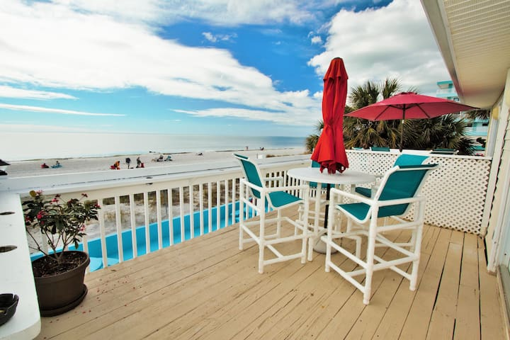 Two bedroom two bath beach front condo. Stunning ocean views. Ocean front patio.