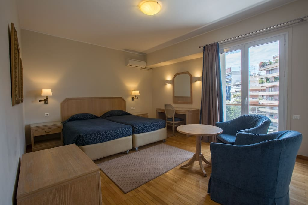 Spacious bedroom includes a dressing table, a sitting area and a bed that can be set as a double bed or 2 single beds!