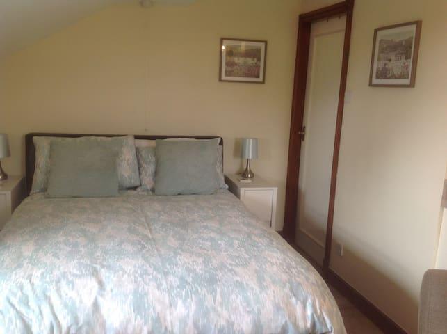 Sleeping area with adjacent shower room.