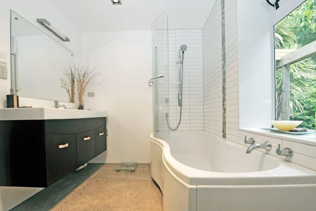 Private use of luxury bathroom with shower and bath.