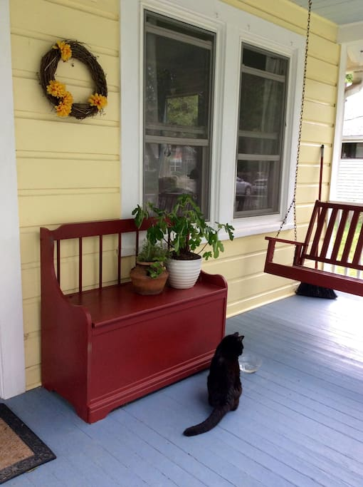 Our outdoor cat will greet you on the front porch.