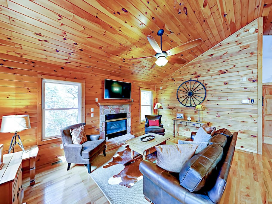Cabin-style interiors with rich wood-paneling on the walls and brand-new furnishings in every room.