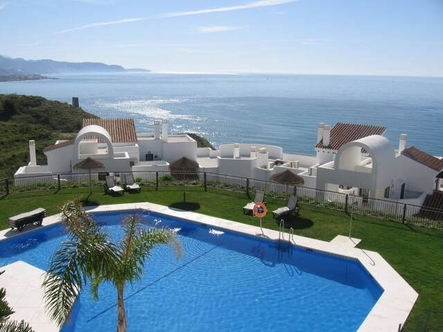 Sea View Apartment | Enjoy the Outdoor Pools and Solarium!