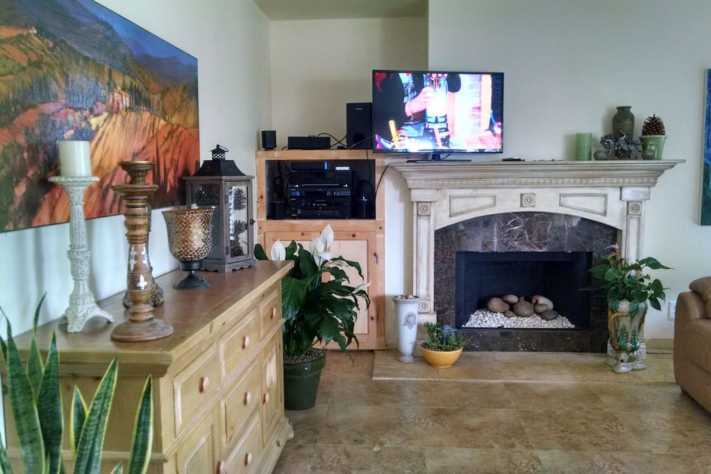 Family room with gas fireplace and flat screen tv w large leather couch