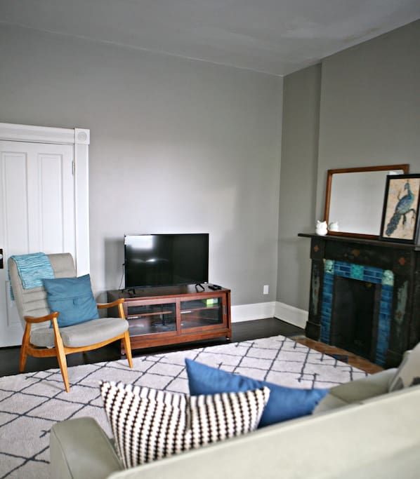 Spacious living room with smart TV and WiFi