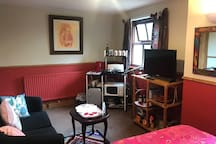 Microwave, hob, mini-fridge, toaster & kettle, sofa, tv with dvd, all available in room