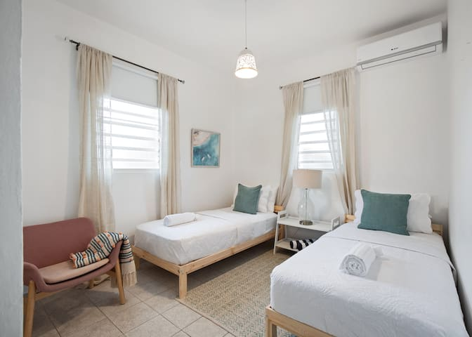 Two single beds in the second room