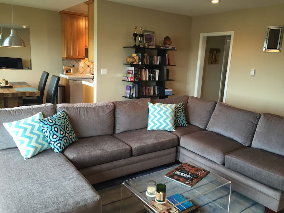 Comfy large couch for lounging and enjoying cable TV or Netflix.