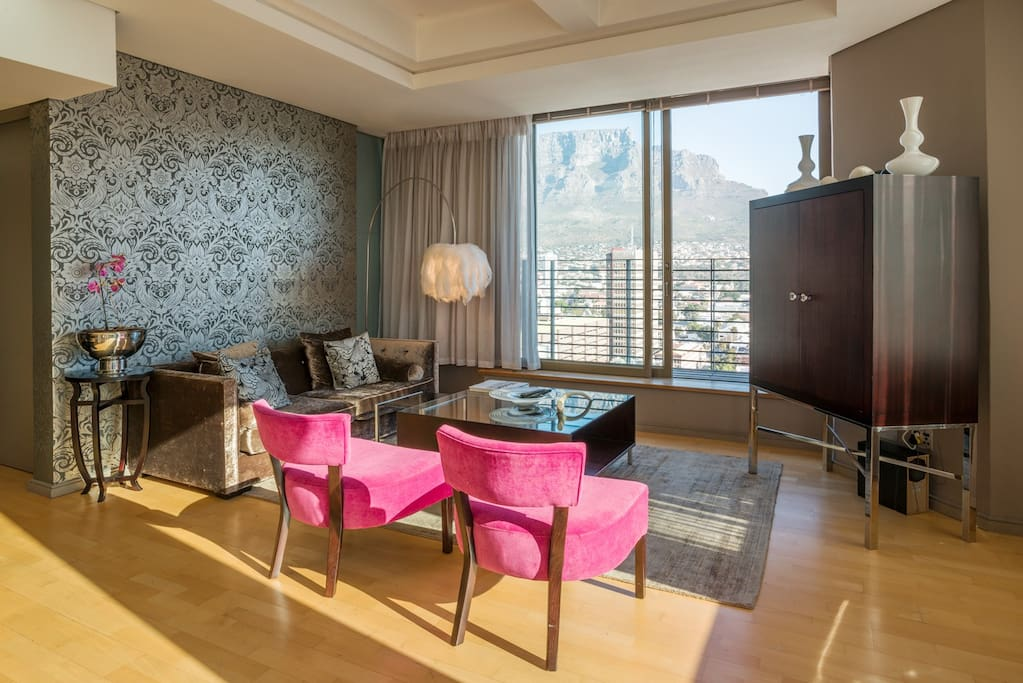 The Large living room with breathtaking views across the city to Table Mountain