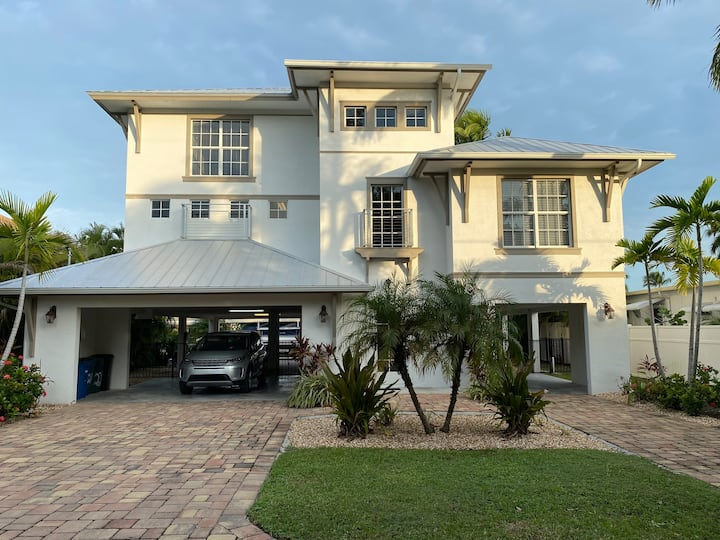 Waterfront Luxury | Walk to Beach | Heated Pool