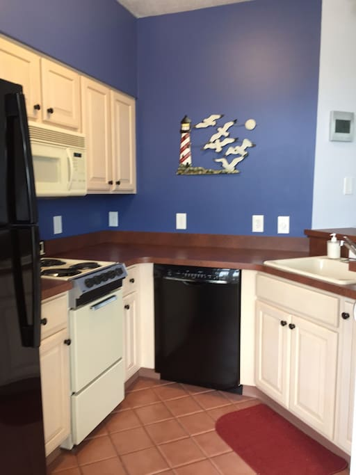 Recently updated Kitchen with a new refrigerator and dishwasher. Adjoining breakfast bar
