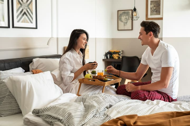 Surprising your loved one with breakfast in bed. What a beautiful way to start your holiday trip.