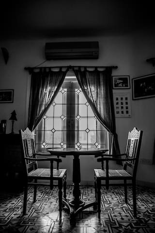 the stained glass windows and the goa chairs