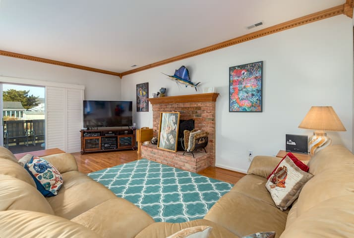 Family/TV room. Decorative fireplace (not for use)