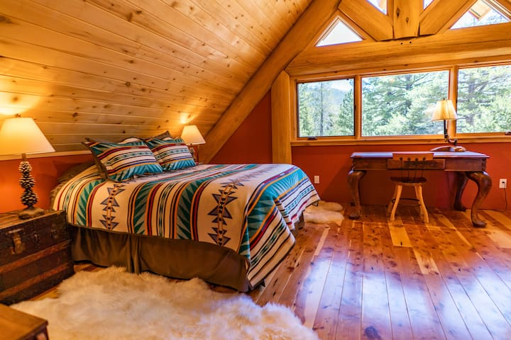 Aspen Suite is a spacious room with comfortable queen bed, table and private bath with sink, toilet and walk-in shower.  This room is ideal for working remotely or just relaxing!