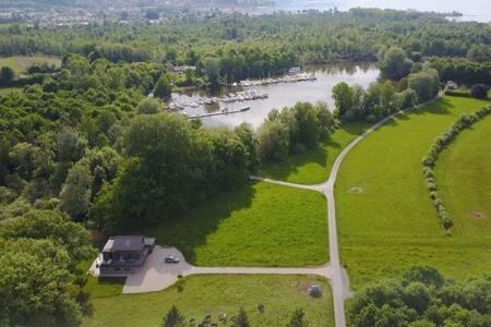 """Swiss Lake Lodge""  bordering the Lake of Geneva"
