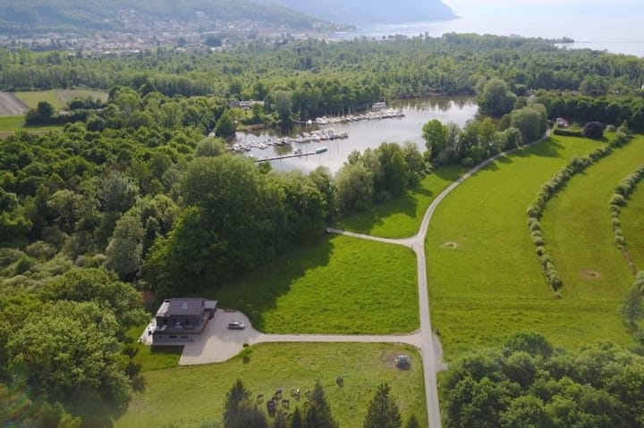 """Swiss Lake Lodge""  bordering the Lake of Geneva"