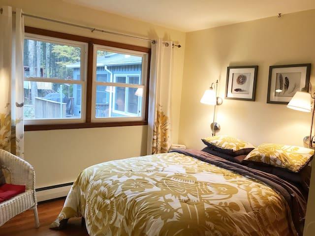 Bedroom 2: Queen bed, with views of the woods.