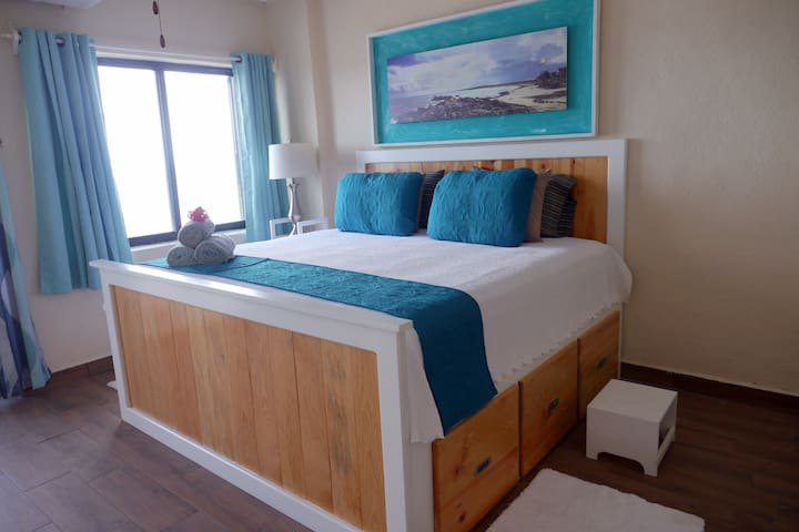 Lovely ocean view bedroom with king size bed plus big closet, storage drawers below bed, dresser table and mini wet bar area!