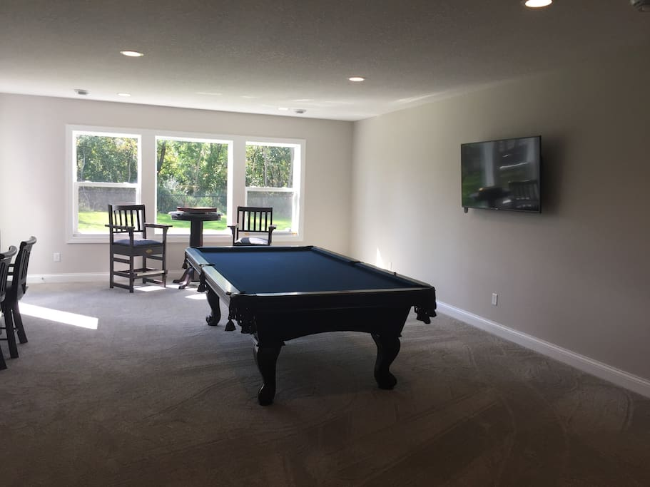 Huge 9 foot billiards/pool table with seating and wallmounted TV