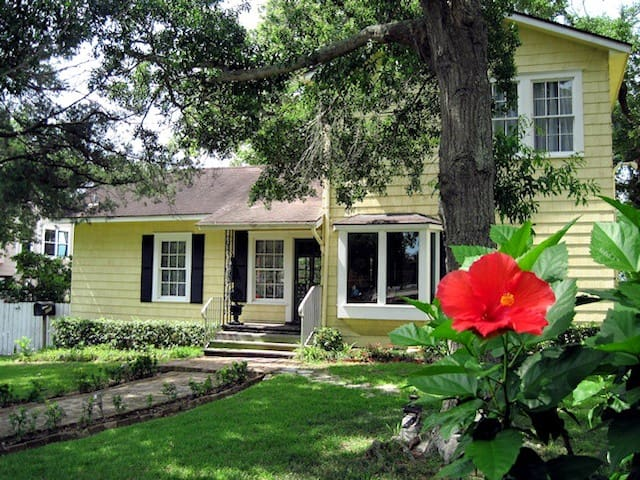 Beacon Hill Bed and Breakfast in Seabrook, Tx, faces NASA Pkwy.  The back opens onto the lawn that touches the lake.  Mature oaks, cedars, crepe myrtles and magnolia trees provide shade on those breezy summer days.  Take a step back in time to relax.