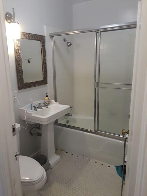 Full bathroom: Sink, toilet, tub, and shower