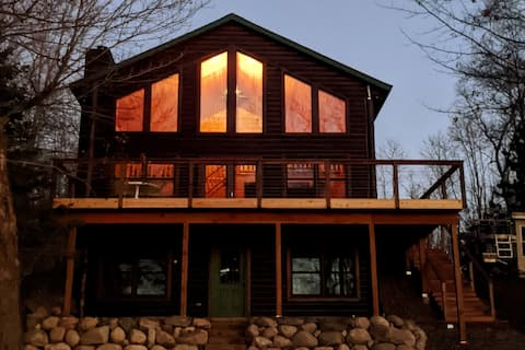 Spacious lakeside cabin with sandy swimming area.