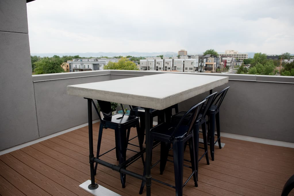 Enjoy dinner on our roof deck with views of the mountains and downtown Denver