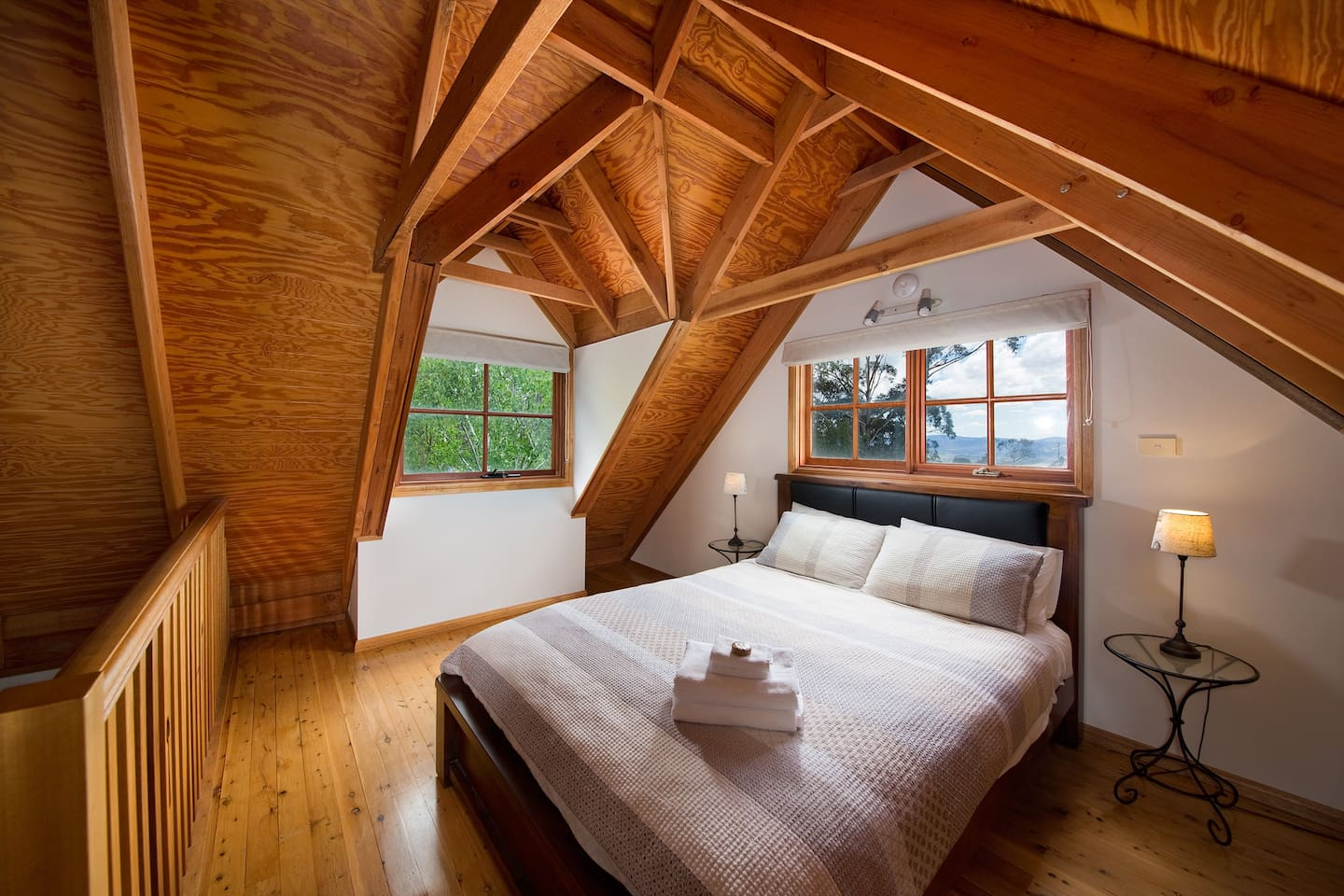 The loft bedroom with views of the Kanimbla valley. Classic Blue Mountains cottage style. Premium A.H.Beard Kingcoil mattress.
