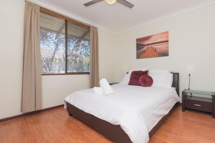 Spacious master bedroom with a homely feel
