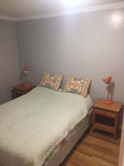 Cozy & Comfortable Queen (real) bed with two nightstands and reading lamps