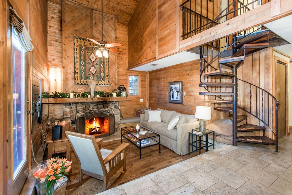 Main floor living room with wood burning fireplace, flat screen TV, seats 5.