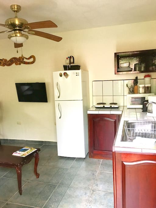 Fully equipped kitchen with full size fridge