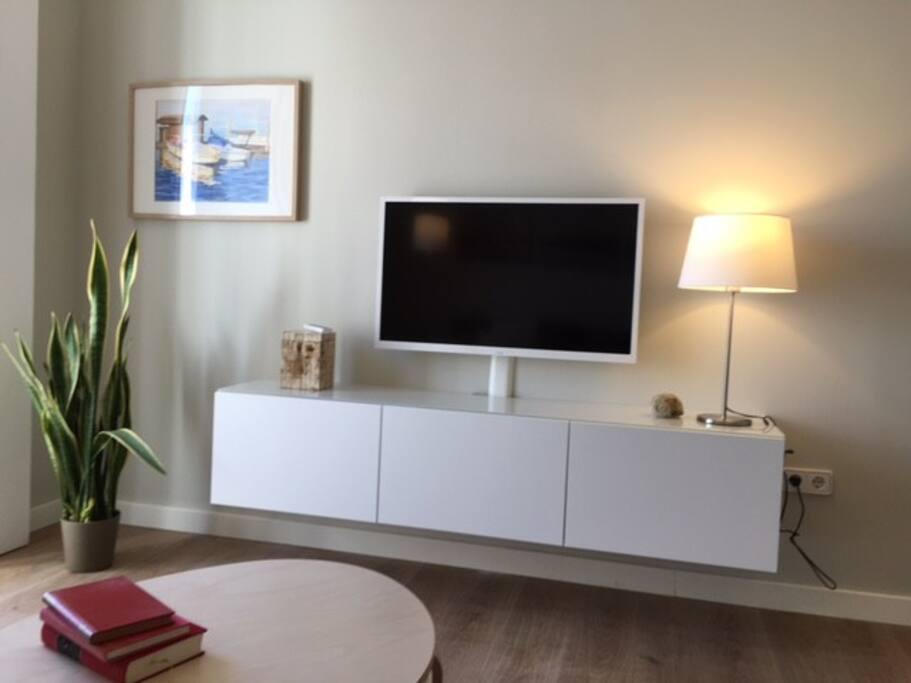 Large flat-screen TV and docking station for your music.