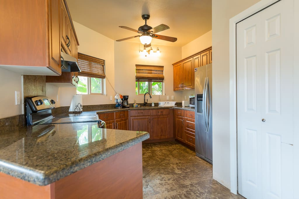 The large kitchen is tiled and has granite countertops all throughout! It is also fully equipped with every kitchen appliances and utensils needed in preparing a complete meal.