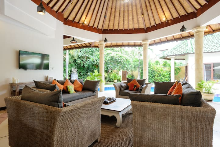 Watch a movie, listen to music or enjoy a Bintang (or two) while looking out to the pool and garden.
