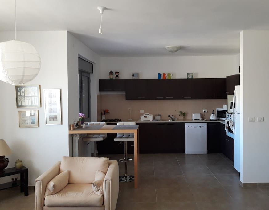 Fully equipped kitchen, Toaster, Kettle, Large fridge and all the utensils you`ll ever need to cook a feast! The kitchen has sit down balcony with a plastic table suitable for 4-8 people facing west and very suitable for breakfast in the cool Jerusalem air.