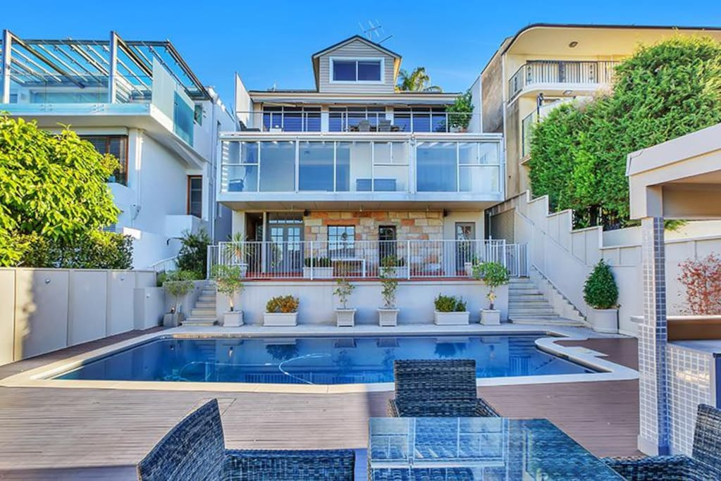Spacious lower level saltwater pool and BBQ Cabana entertaining area.