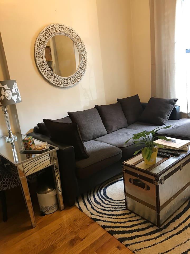 Living room with desk/workstation.