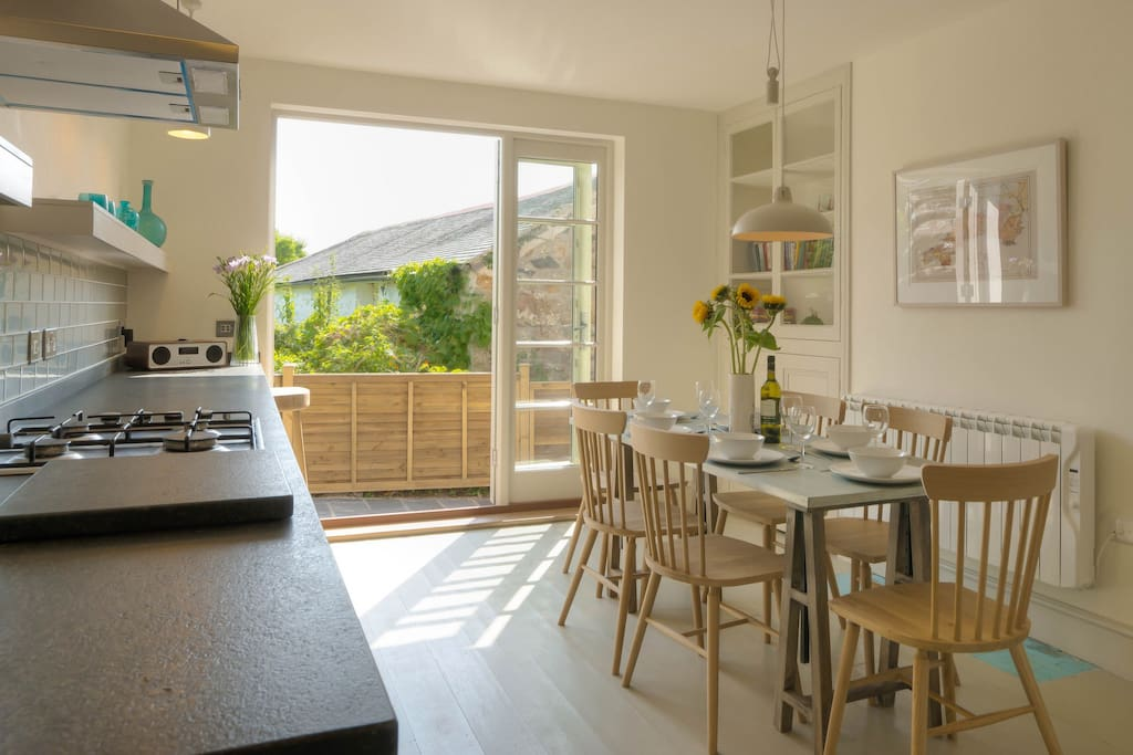 Huge eat in kitchen with French doors to the terrace